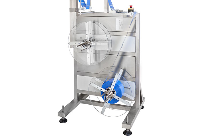 AFM LX-350 shrink sleeve labeler's dual film unwind maintains shrink film tension during high speed operations
